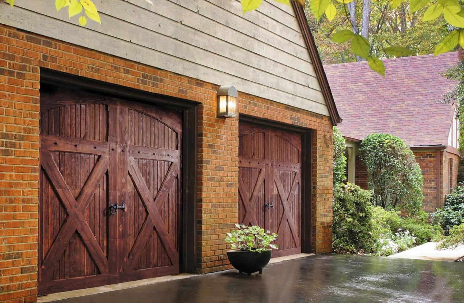 Old world style garage door with vertical lats and cross bars